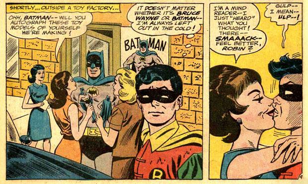 Batman signiert Figuren, Robin kriegt Küsschen.